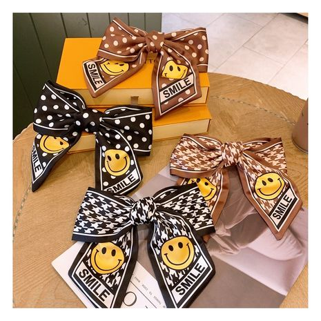 Korean   silk big bow yellow smiley face  wide version  hairpin  NHHD272257's discount tags