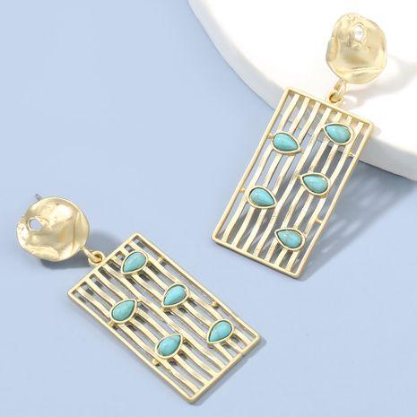 Boucles d'oreilles turquoise en alliage creux à rayures verticales carrées simples exagérées à la mode NHJE272307's discount tags