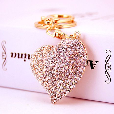 Korean  creative diamond-studded white peach heart car keychain  NHAK272814's discount tags