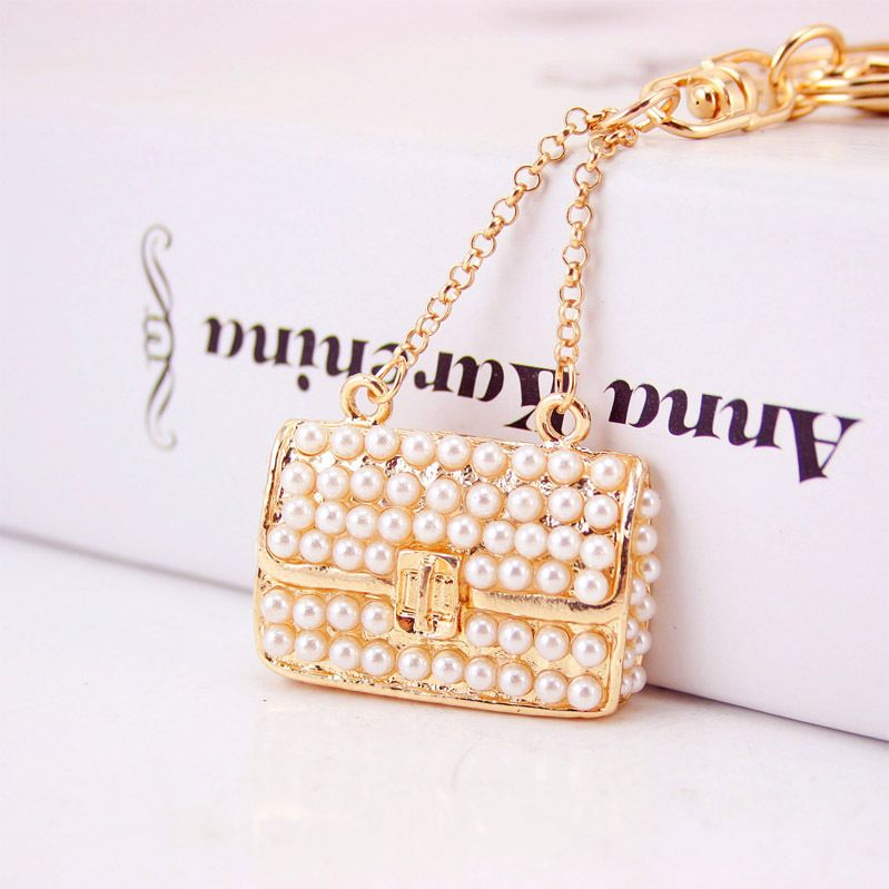 Korean  creative cute ladies pearl handbag key chain  NHAK272817