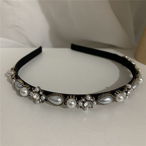 Korean sweet pearl rhinestone hair band  NHYQ274233's discount tags