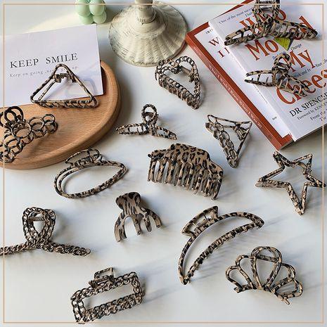 Clip moyen en métal à imprimé léopard NHOF274310's discount tags