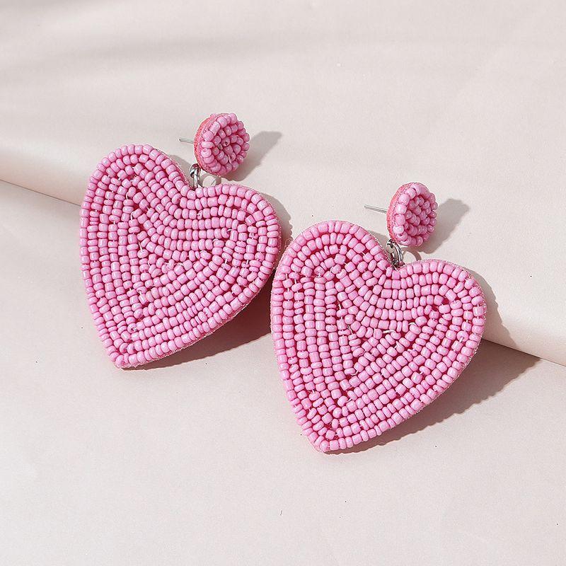 fashion creative wild popular rice beads peach heart earrings NHPS265037