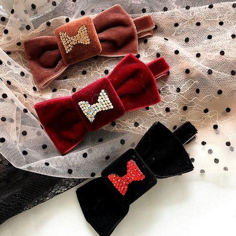 Korean new diamond bowknot gold velvet   clip NHHI265285's discount tags