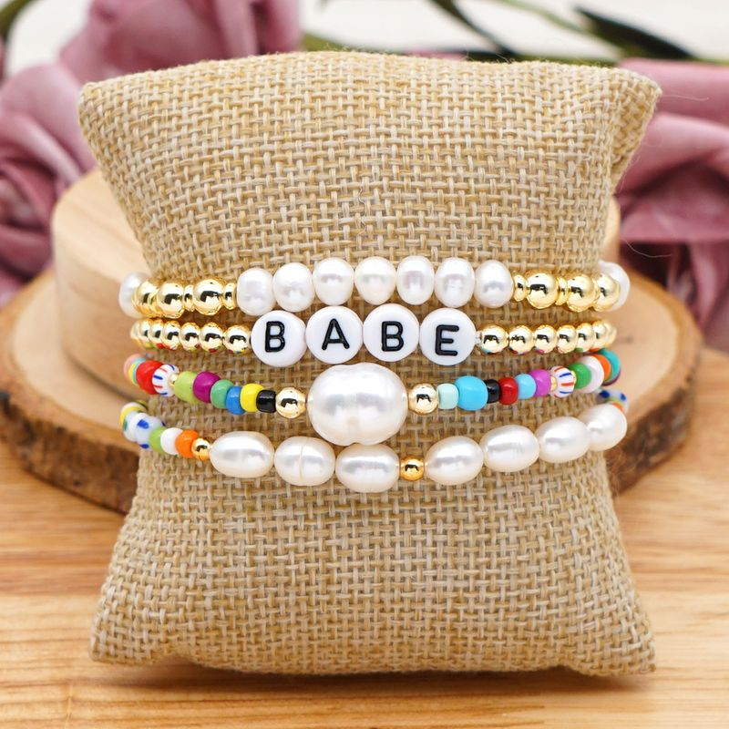 Bohemian colored rice bead letters multi-layered  simple  natural freshwater pearl bracelet NHGW265658