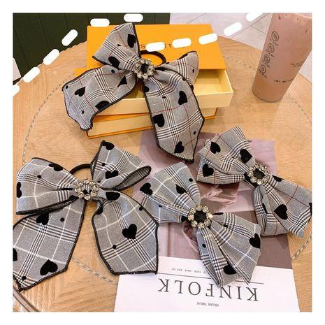 Korea retro wave dot big bow ribbon  diamond hair ring clip NHHD265736's discount tags