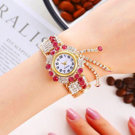 Nuevo reloj creativo de la pulsera del cuarzo de la borla de la moda de la aleación de la moda NHHK267225's discount tags
