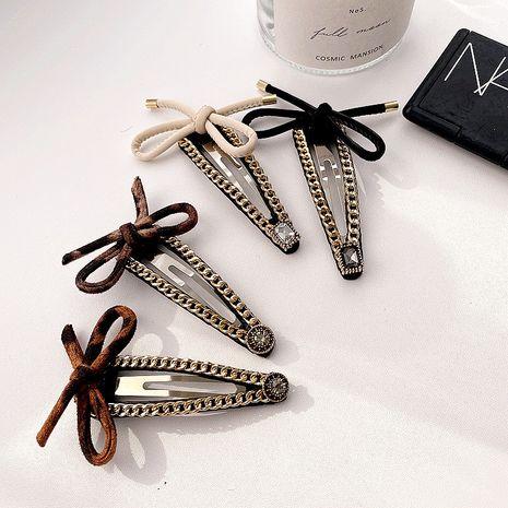 Korean retro metal diamonds leopard print bow hair clip NHHI281224's discount tags