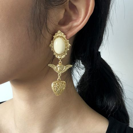 Baroque retro portrait hollow alloy resin earrings NHMD281959's discount tags