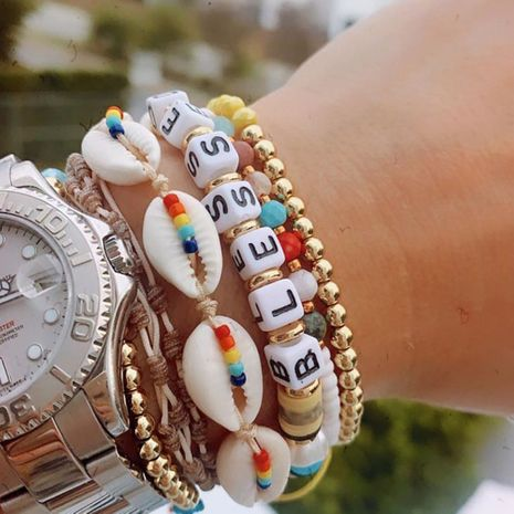 Bohemian Shell Gold Beads Pearl Stacked Soft Pottery Letter Bracelet NHGW283335's discount tags