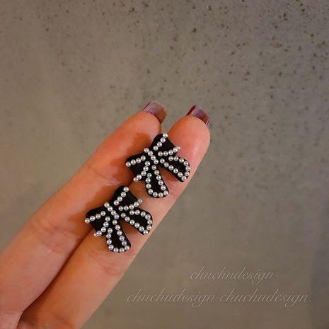 Boucles d'oreilles noires avec nœud et perles NHXI283383's discount tags