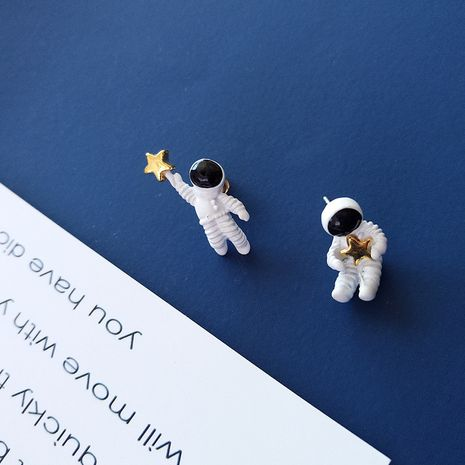 S925 Silver Needle Cute Spaceman Astronaut Earrings NHXI283392's discount tags