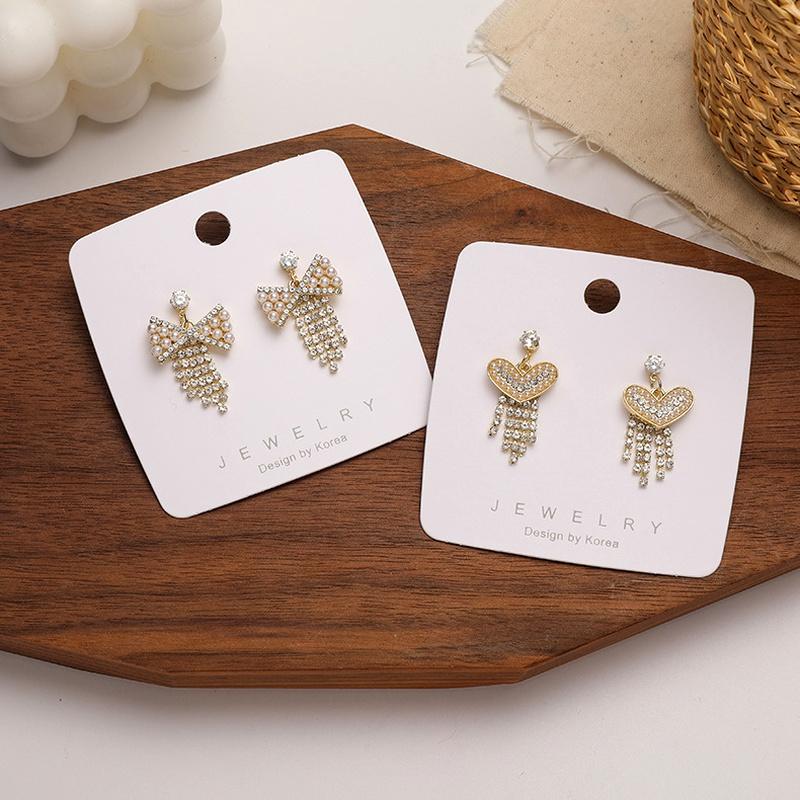 Retro fashion pearl rhinestone bow tassel earrings NHMS283525