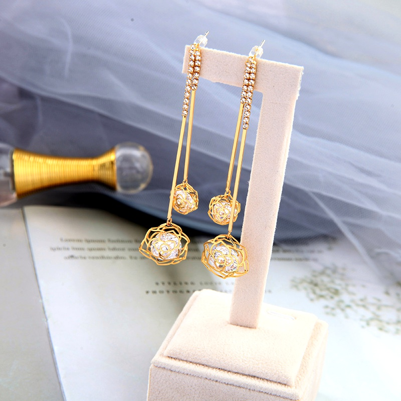 Tassel fashion retro long hollow flower earrings NHQD283725
