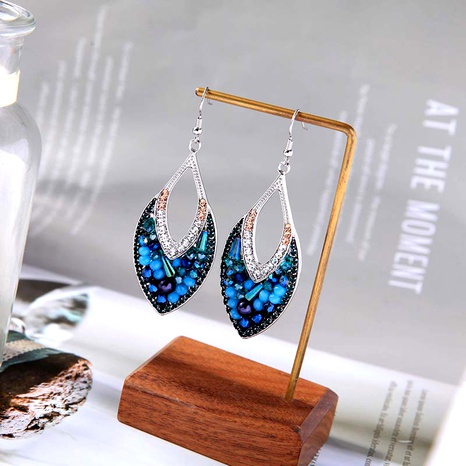 fashion fan-shaped peacock blue retro earrings NHQD283734's discount tags