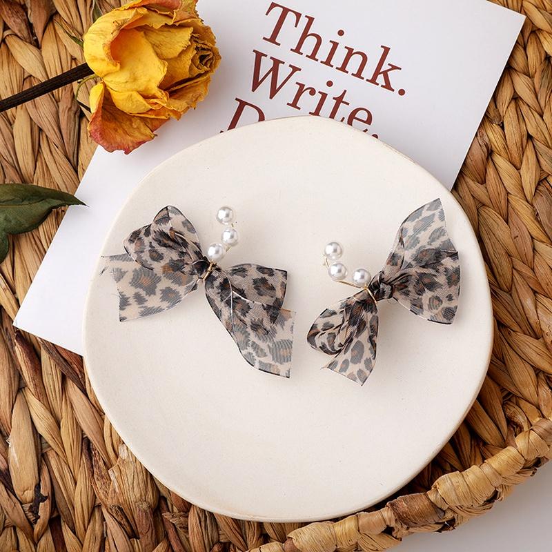 Sweet pearl leopard bow earrings NHMS284989