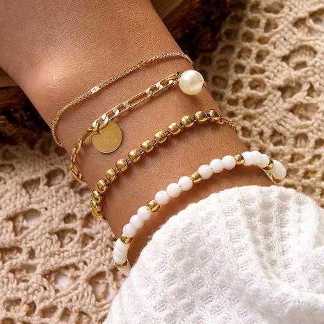 Bohemian Vintage Four-Layer Disc Imitation Pearl White Beaded Alloy Bracelet Set NHGY285560's discount tags