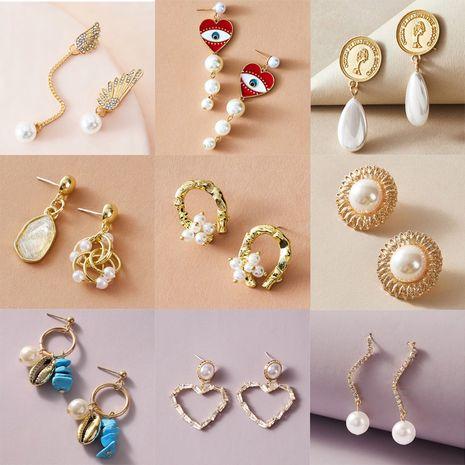 asimétrico retro círculo ojos alas pendientes de perlas de circonio NHGY277096's discount tags