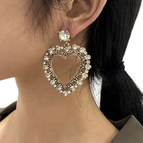 Diamond-studded Heart Geometric Hollow Earrings NHMD277247's discount tags