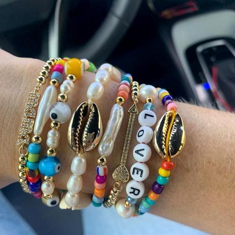 Bohemian pearl multi-layered beaded bracelet set NHGW286539's discount tags