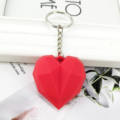 New PVC geometric faceted peach heart keychain  NHAP288425's discount tags