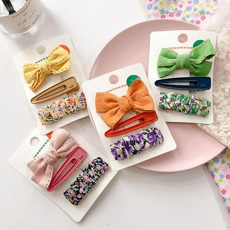 Nuevo clip de prensa de lazo floral de tela de color caramelo estilo nórdico coreano NHHI277940's discount tags