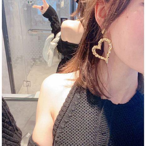 boucles d'oreilles rétro coeur en métal à surface convexe creuse NHYQ278827's discount tags