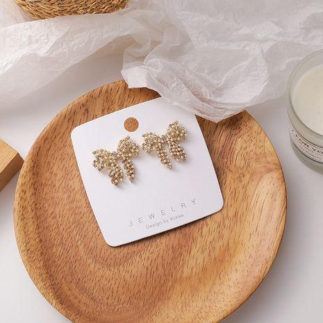 Korean big bow full diamond hollow pearl earrings  NHMS279035's discount tags