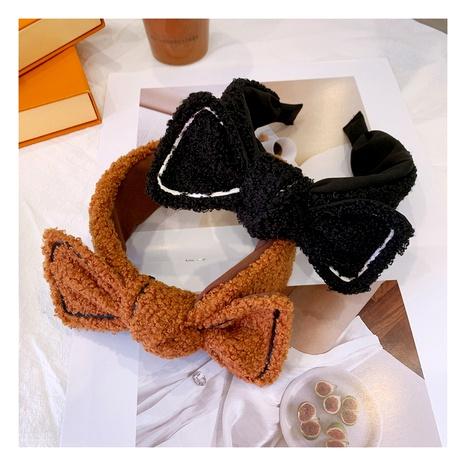 Korean retro  cute warm lamb hair bow hair band NHHD289812's discount tags
