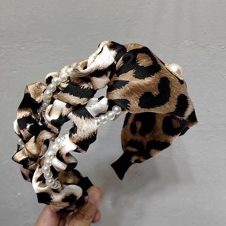 Banda ancha de perlas con estampado de leopardo NHAR293884's discount tags