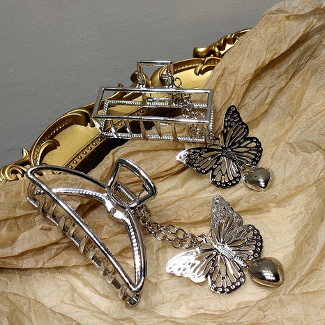 Metal butterfly pendant catch clip NHAR293887's discount tags