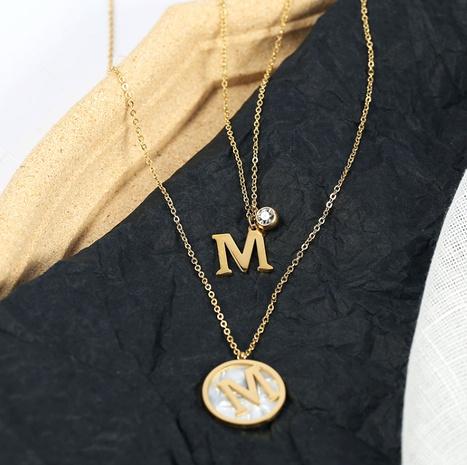 Collier double épaisseur lettre M en acier titane NHAB295587's discount tags