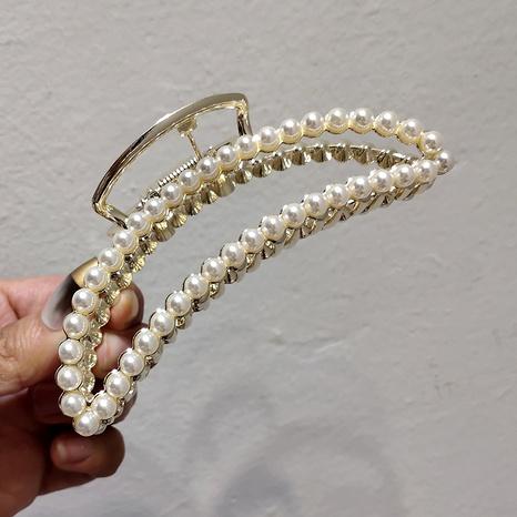 Korea's alloy rhinestone pearl hair clip NHAR295635's discount tags