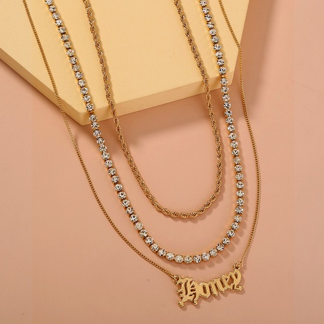 collier pendentif lettre gothique chaîne torsadée NHAN295926's discount tags