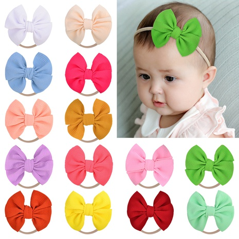 Children's nylon headband 4.8 inches corn kernels solid color bow hair ring headwear NHMO295991's discount tags
