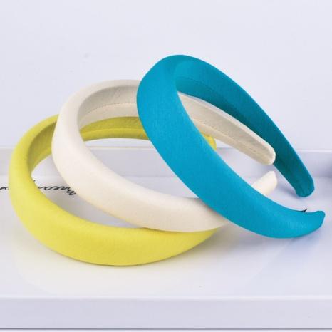 einfaches reines farbiges Schwammstirnband NHAQ297024's discount tags