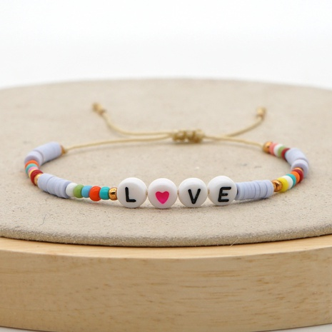 Simple bohemian ethnic style hand-woven colorful 4mm soft pottery love letter bracelet NHGW298107's discount tags