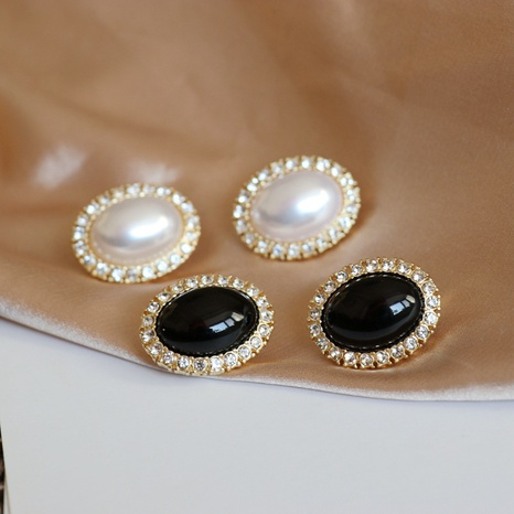 Oval white black diamond earrings NHOM300062's discount tags