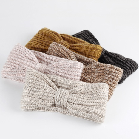 Korean wool bowknot knitted headband NHAR300671's discount tags