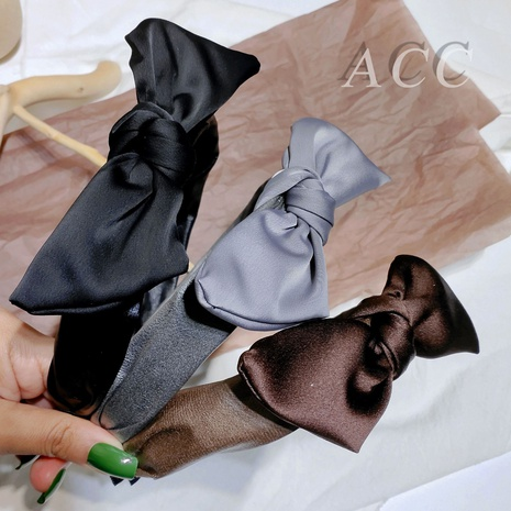 simple bowknot PU leather headband NHAR300680's discount tags