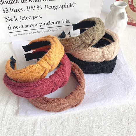 Korean retro solid color wool knitting wide side knotted headband  NHOF300859's discount tags