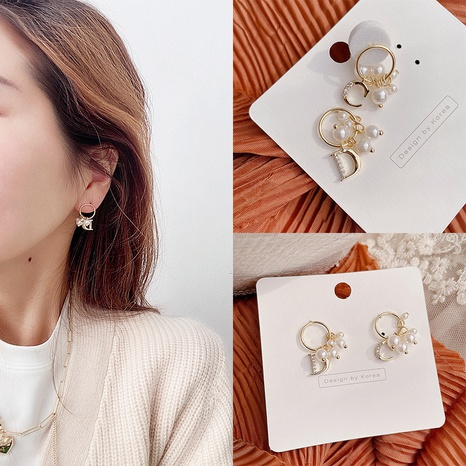 Korean new gold plated pearl asymmetric letters earrings NHHI301357's discount tags