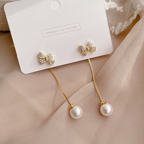 Korean new simple pearl bowknot earrings NHHI301358's discount tags