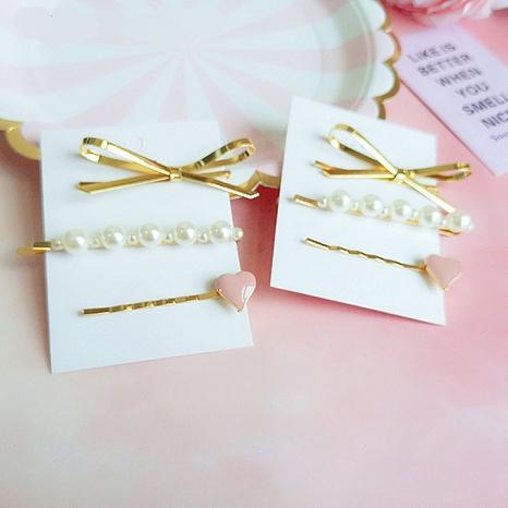 Épingle à cheveux d'amour de perle d'arc en métal de mode coréenne NHGE302235's discount tags