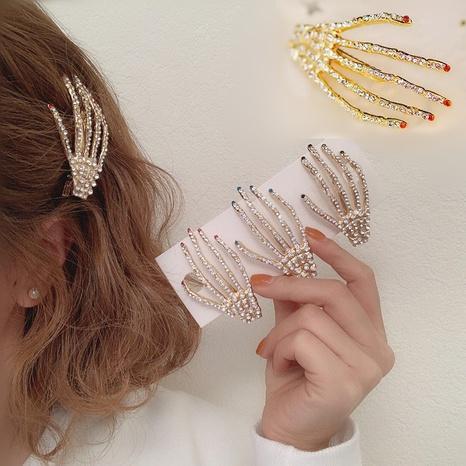 Fashion skull hand claw hand bone hairpin  NHGE302259's discount tags