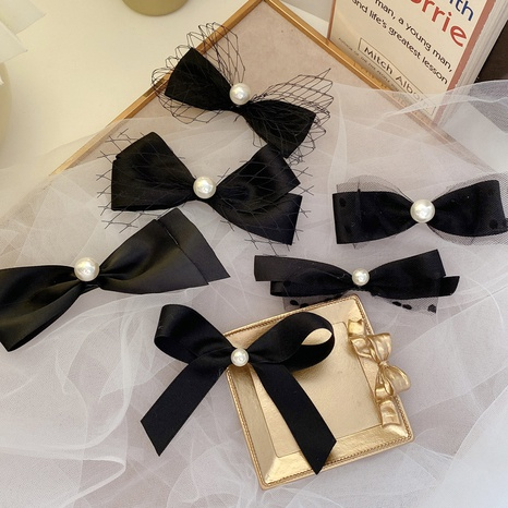 Korea new black net yarn pearl bow hairpin NHCQ302274's discount tags