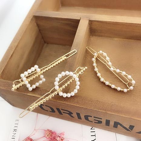 Korean simple pearl geometric side clip  NHDQ302523's discount tags