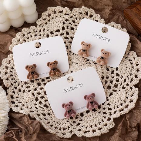 Lindos pendientes de oso con lazo flocado NHMS292043's discount tags