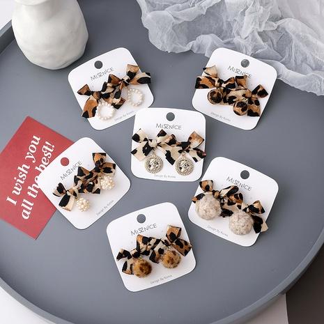 leopard print hair ball earrings  NHMS292058's discount tags