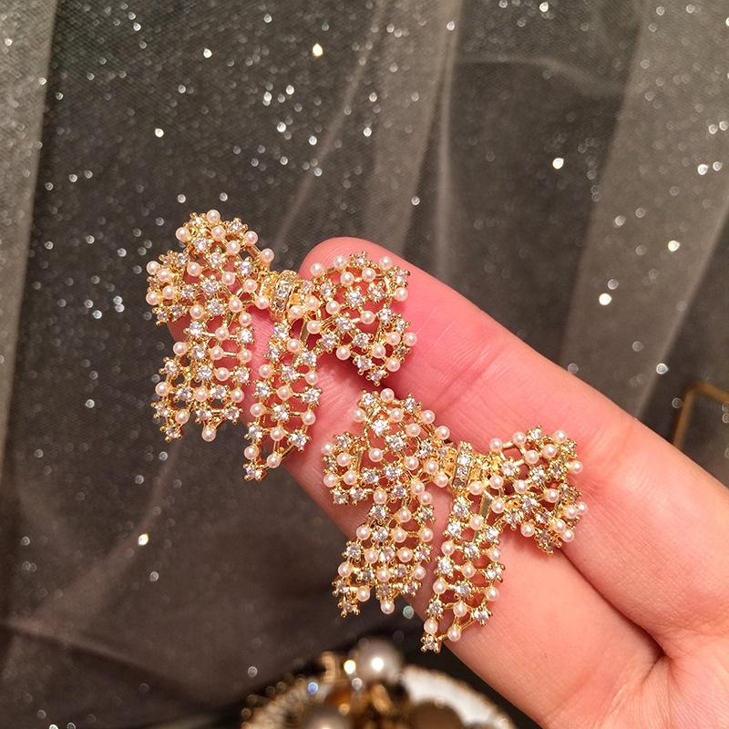 Pearl bow earrings NHWK292705